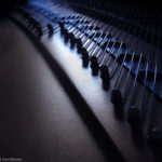 Photo of The Pins and Strings of a Grand Piano