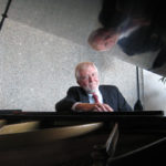 Jim Gibson at a grand piano