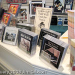 Photo of countertop display of Jim Gibson's solo piano CDs.