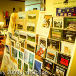 Retail display in North Carolina art gallery featuring Jim Gibson's solo piano CDs.