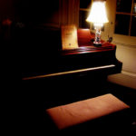 Photo of cozy living room with grand piano.